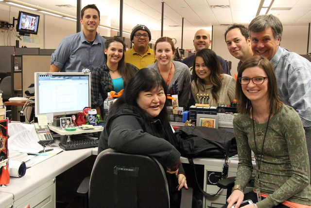 Review-Journal staffers gather around editor Lisa Kim Bach's desk on November 20, 2014. From left to right: Colton Lochhead, Ashley Casper, Ricardo Torres, Lisa Kim Bach (center), Kimber Laux, A.J ...