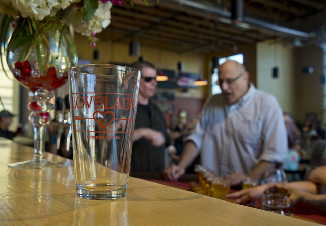 Michael Morgan, left, and John Slyman talk during the grand opening of Lovelady Brewery and Taproom in downtown Henderson on Friday, April 1, 2016. Daniel Clark/Las Vegas Review-Journal Follow @Da ...