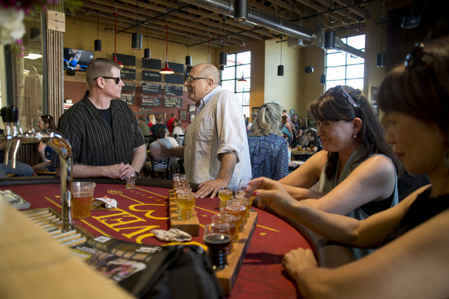 From left, Michael Morgan, John Slyman, Yumi Morgan, and Hidemi Slyman talk during the grand opening of Lovelady Brewery and Taproom in downtown Henderson on Friday, April 1, 2016. (Daniel Clark/L ...