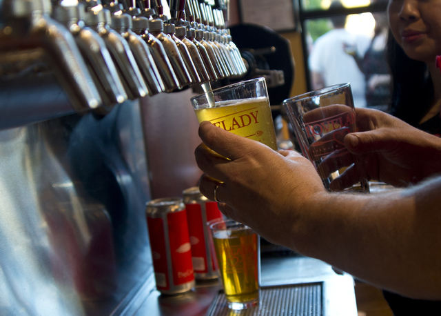Richard Lovelady draws a beer rom a tap during the grand opening of Lovelady Brewery and Taproom in downtown Henderson on Friday, April 1, 2016. (Daniel Clark/Las Vegas Review-Journal) Follow @Dan ...