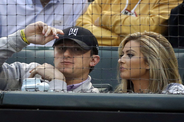 Cleveland Browns quarterback Johnny Manziel, left, sits with Colleen Crowley during a baseball game between the Los Angeles Angels and the Texas Rangers in Arlington, Texas. (LM Otero/AP)