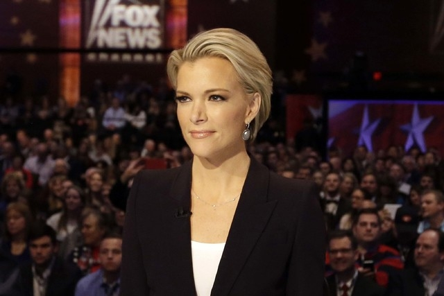 Moderator Megyn Kelly waits for the start of the Republican presidential primary debate in Des Moines, Iowa, Jan. 28, 2016. (AP Photo/Chris Carlson)