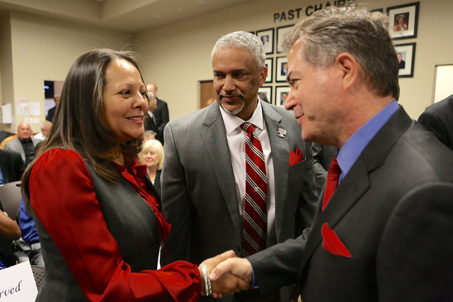 UNLV president Len Jessup, right, shakes hands with Tammy Menzies wife of new UNLV men's basketball coach Marvin Menzies, center, during a Regents meeting on Friday, April 22, 2016. (Jeff Scheid/L ...
