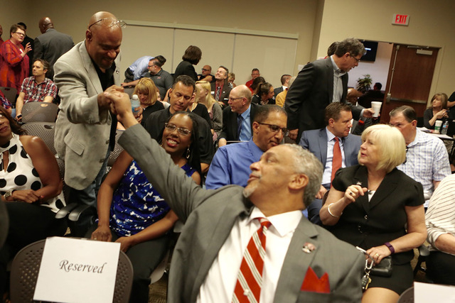 New UNLV men's basketball coach Marvin Menzies, right, fist bumps with a supporter during a Regent hearing on Friday, April 22, 2016. (Jeff Scheid/Las Vegas Review-Journal)
