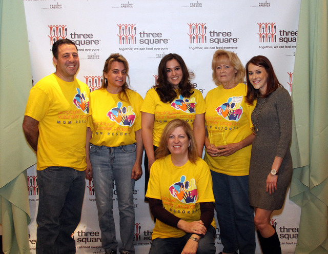 From left, Mark Ostrovsky, Debbie Clarke, Shadi Barzideh, Barbara Hudson, Three Square volunteer coordinator Mikell Goheen and, in front, Tina Hachikian pose April 11 during Three Square food bank ...