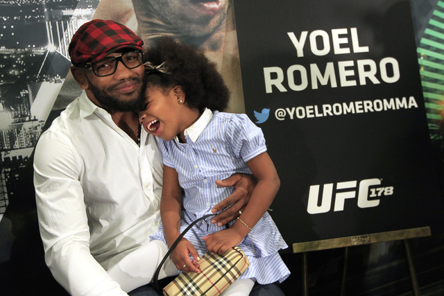 Kalixia Romero laughs while sitting on her father Yoel Romero's lap during media day in advance of UFC 178 Thursday, Sept. 25, 2014 at the MGM Grand. (Sam Morris/Las Vegas Review-Journal)