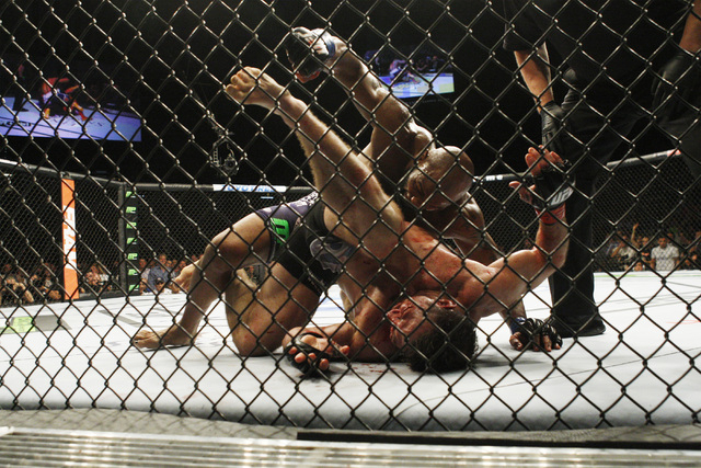 Yoel Romero pounds on Tim Kennedy on his way to a second round TKO during their fight at UFC 178 Saturday, Sept. 27, 2014 at the MGM Grand Garden Arena in Las Vegas. (Sam Morris/Las Vegas Review-J ...