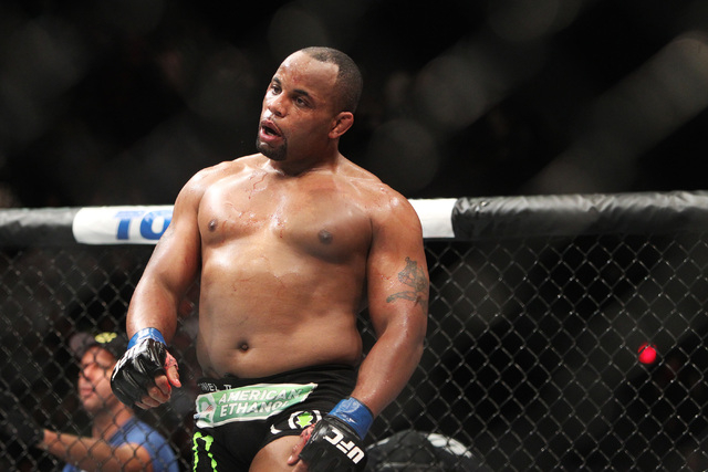Daniel Cormier struts around the octagon after submitting Anthony Johnson during their light heavyweight title fight at UFC 187 Saturday, May 23, 2015, at the MGM Grand Garden Arena.  (Sam Morris/ ...