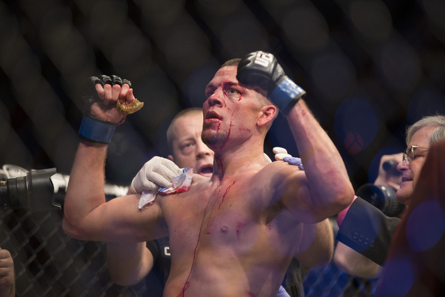 Nate Diaz celebrates his win against Conor McGregor in their menճ welterweight title bout during UFC 196 at MGM Grand Garden Arena on Saturday, March 5, 2015 in Las Vegas. Diaz won by way of subm ...