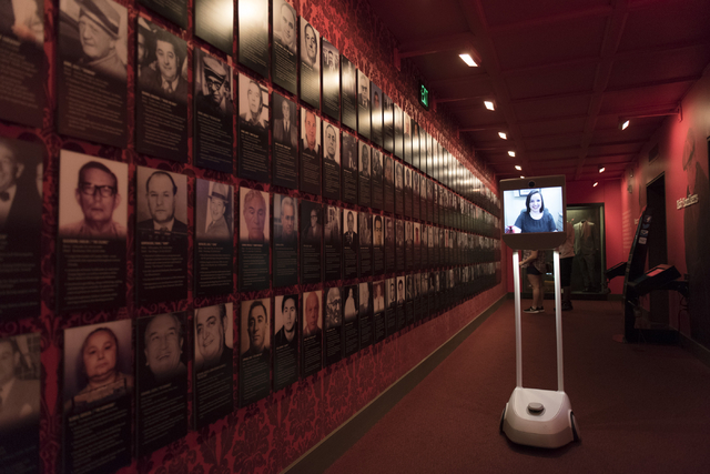 "Misha Ray, digital marketing manager with The Mob Museum, is displayed on a ""Moe-Bot"" screen as she gives a demonstration of a virtual tour at museum in Las Vegas Thursday, April 7, 2016. The muse ..."