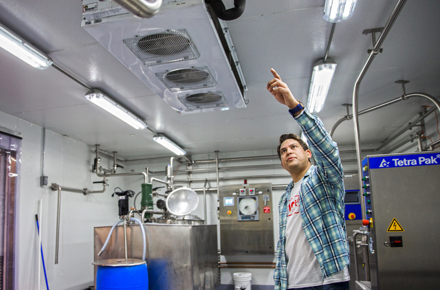 "Leif Pearson, chief operating officer at Momenti Spirited Ice Creams, checks the mixing tank at the facility of the alcohol-infused ice cream producer, Tuesday, April 26, 2016, in Las Vegas. ""I lo ..."