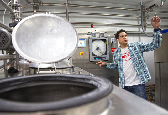 "Leif Pearson, chief operating officer at Momenti Spirited Ice Creams, checks the mixing tank at the facility of the alcohol-infused ice cream producer, Tuesday, April 26, 2016, in Las Vegas. ""It's ..."