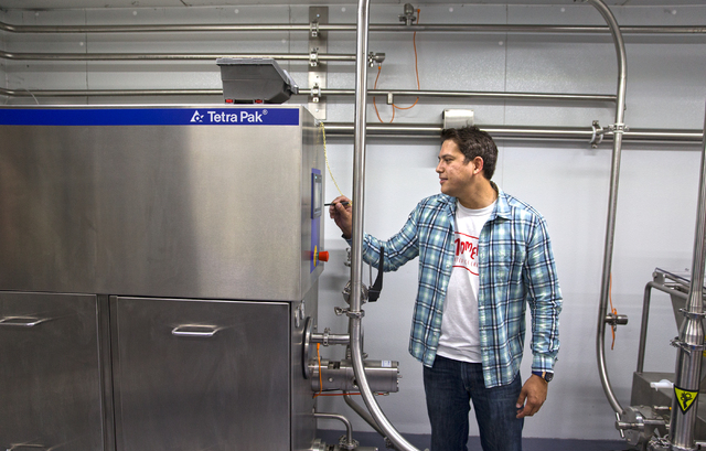 "Leif Pearson, chief operating officer at Momenti Spirited Ice Creams, checks the mixing tank at the facility of the alcohol-infused ice cream producer, Tuesday, April 26, 2016, in Las Vegas. ""I sa ..."