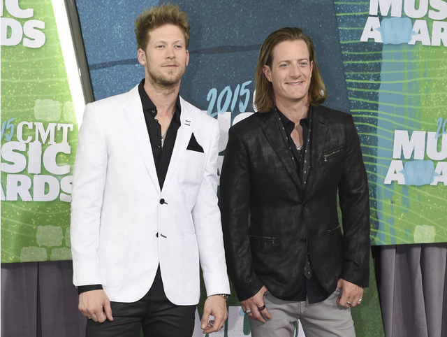 Brian Kelley, left, and Tyler Hubbard, of Florida Georgia Line, arrive at the CMT Music Awards at Bridgestone Arena, in Nashville, Tenn., last year. (Sanford Myers/The Associated Press)