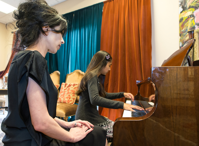 Teacher Lilith Tonapetian, left, watches Jina Umakanthan, 12, play DeBussy's Clair de lune, at Renaissance Music Academy in Henderson, Nev. on Friday, April 15, 2016. Donavon Lockett/Las Vegas Rev ...