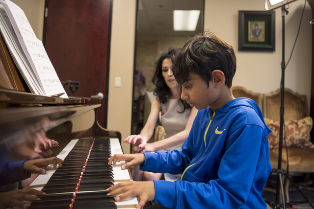 Sachin Reddy plays the piano as Lilith Tonapetian looks on at Renaissance Music Academy in Las Vegas on Friday, April 8, 2016. Joshua Dahl/Las Vegas Review-Journal