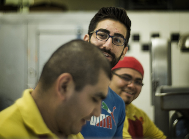 Haidar Karouni, center, jokes with coworkers while working at the his family's Afandi Restaurant, 5181 W. Charleston Blvd. on Friday, Nov. 13, 2015. Karouni is waiting for is U.S. citizenship to b ...