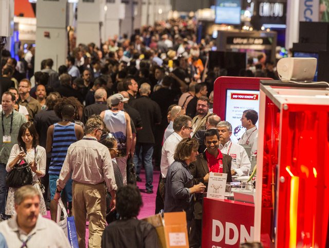 People walk in the South Hall in the Las Vegas Convention Center, 3150 Paradise Road  Monday, April 13, 2015 during  the  National Association of Broadcasters Show. Around 100,000 people in the me ...