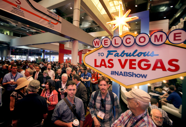 People walk in the Las Vegas Convention Center, 3150 Paradise Road  Monday, April 13, 2015  during the  National Association of Broadcasters Show. Around 100,000 people in the media and entertainm ...