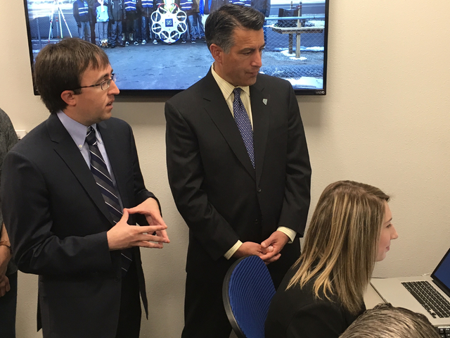 Gov. Brian Sandoval gets a demonstration of the new lab from UNR robotics professor Richard Kelley and UNR student Camille Bourquin on Wednesday, April 6, 2016. Sean Whaley/Las Vegas Review-Journal