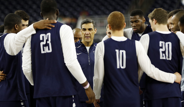 Villanova head coach Jay Wright talks to his players during a practice session for the NCAA Final Four college basketball tournament Friday, April 1, 2016, in Houston. (AP Photo/David J. Phillip)