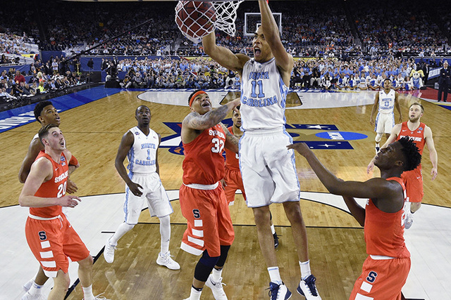 North Carolina forward Brice Johnson (11) dunks the ball against Syracuse during the first half of the NCAA Final Four tournament college basketball semifinal game Saturday, April 2, 2016, in Hous ...