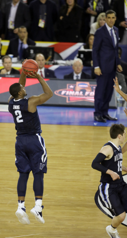 Villanova's Kris Jenkins (2) shoots a game winning three point basket in the closing seconds of the NCAA Final Four tournament college basketball championship game against North Carolina, Monday,  ...