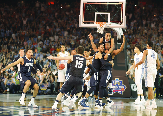 Villanova players celebrate after the NCAA Final Four tournament college basketball championship game against North Carolina, Monday, April 4, 2016, in Houston. Villanova won 77-74.  (AP Photo/Kii ...