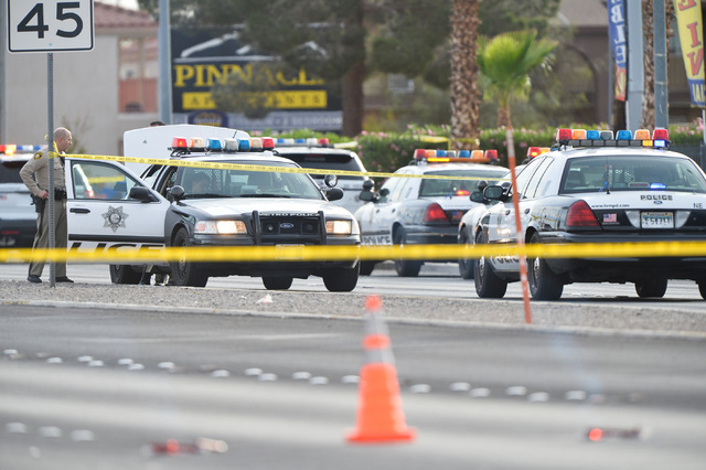 Las Vegas police investigate a homicide at Cohiba Courts Apartments on Thursday, April 7, 2016. The call initially came in as a family disturbance, and when police arrived they found a body on the ...