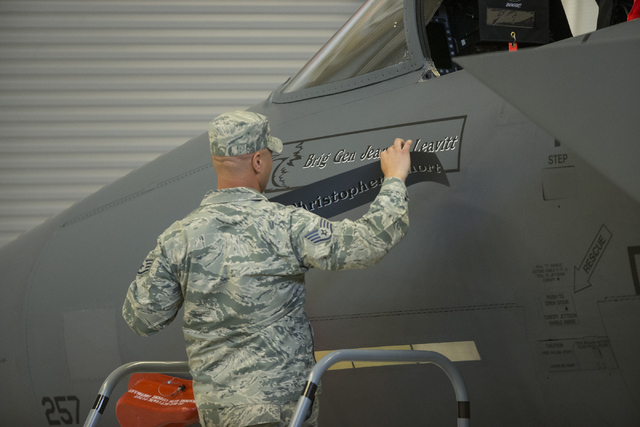 Brig. Gen. Jeannie Leavitt's name is revealed on a F-15 Strike Eagle after her change in command ceremony for the 57th Wing at Nellis Air Force Base on Friday, April 15, 2016, in Las Vegas. Leavit ...