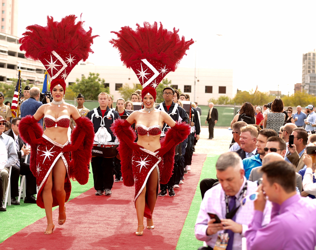 Showgirls lead dignitaries during the Project Neon groundbreaking located near The Smith Center for the Performing Arts in Las Vegas on Thursday, April 7, 2016. The $1.5 billion project will add t ...