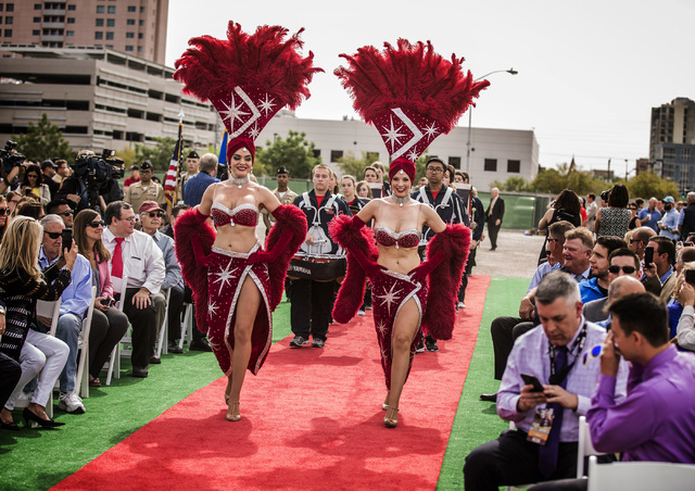 Showgirls lead a procession with the Coronado High School Band and dignitaries Thursday, April 7, 2016 during the groundbreaking for Project Neon near The Smith Center for the Performing Arts in L ...