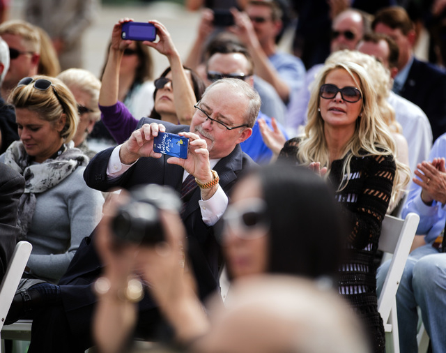 Myron Martin, president and CEO of the Smith Center for the Performing Arts, takes a photo during the groundbreaking for Project Neon, near the venue in Las Vegas on Thursday, April 7, 2016. Jeff  ...