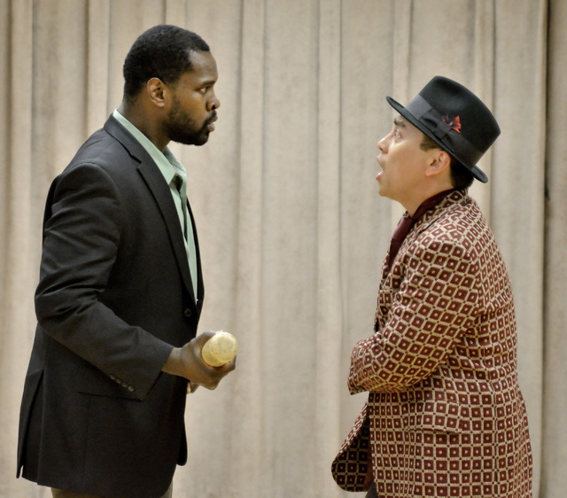 """The theater company manager (Stephon Pettway), left, confronts performer -- and in-debt gambler -- Bill Calhoun (Lysander Abadia) in """"Kiss Me Kate,"""" which opens Friday at UNLV's Judy Bayley Theatr ..."""