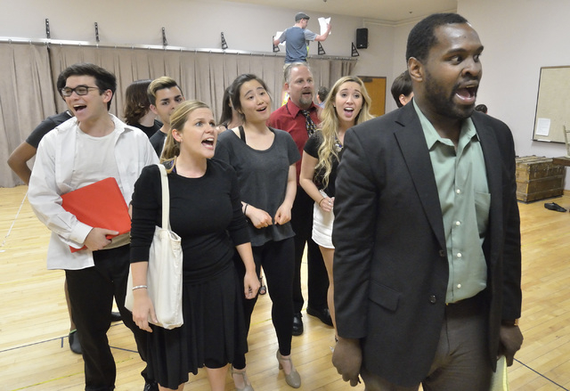 """Stephon Pettway, right, joins fellow cast members to belt out a Cole Porter number during """"Kiss Me Kate"""" rehearsal at UNLV. The Nevada Conservatory Theatre production opens Friday. Bill Hughes/Las ..."""