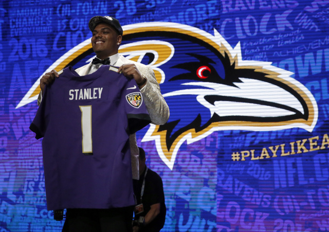 Notre Dames Ronnie Stanley poses for photos after being selected by Baltimore Ravens as the sixth pick in the first round of the 2016 NFL football draft, Thursday, April 28, 2016, in Chicago. (AP  ...