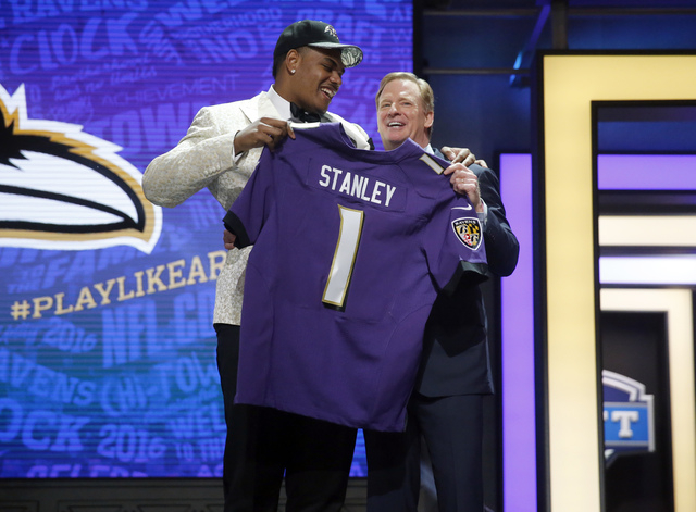 Notre Dames Ronnie Stanley poses for photos with NFL commissioner Roger Goodell after being selected by Baltimore Ravens as the sixth pick in the first round of the 2016 NFL football draft, Thursd ...