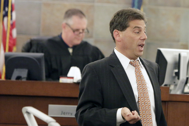 North Las Vegas Police Supervisors Union's attorney Adam Levine addresses the court as judge Jerry Wiese II, left, reviews documents Thursday, March 31, 2016, at Regional Justice Center during an  ...