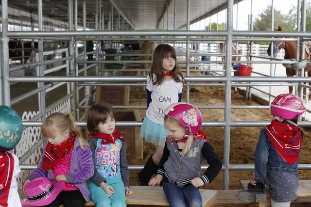 Girls take part in a birthday party at the Horses 4 Heroes stables at Floyd Lamb Park at Tule Springs on April 11. Rachel Aston/View Follow @rookie__rae