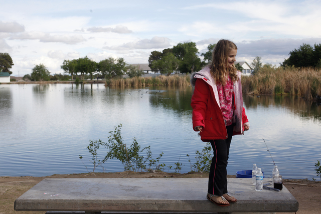Ava Lauricella stands on a table at Floyd Lamb Park at Tule Springs, 9200 Tule Springs Road, April 11. Floyd Lamb Park is one of the various northwest sites that give visitors the sense they are n ...