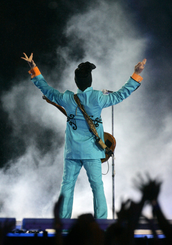 FILE - In this Feb. 4, 2007 file photo, Prince performs during the halftime show at Super Bowl XLI at Dolphin Stadium in Miami. Prince's publicist has confirmed that Prince died at his home in Min ...