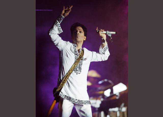 FILE - In this April 26, 2008  file photo, Prince performs during the second day of the Coachella Valley Music and Arts Festival in Indio, Calif. Prince's publicist has confirmed that Prince died  ...