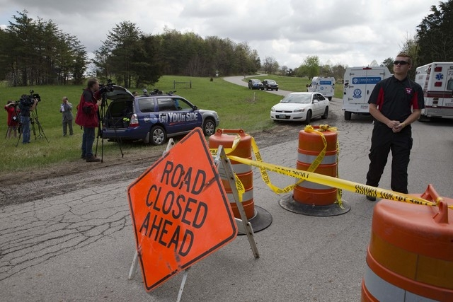 Media and emergency personnel stand at the perimeter of a crime scene as investigation vehicles drive up Union Hill Road, Friday, April 22, 2016, in Pike County, Ohio. Shootings with multiple fata ...