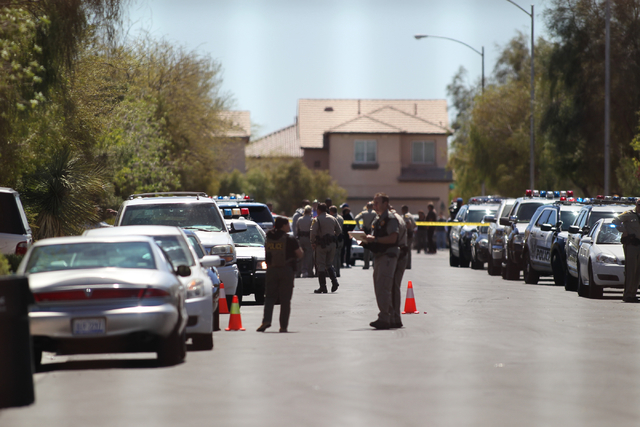 Police work at the scene of an officer involved shooting at 9848 Fast Elk St., near Iron Mountain Road and North El Capitan Way in the far northwest valley on Thursday, March 31, 2016. (Brett Le B ...