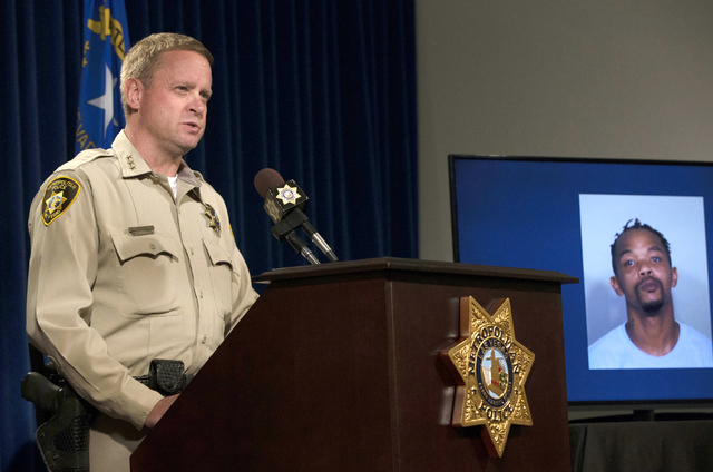 A photo of James Craig Simpson, 31, right, who shot and killed two people, is displayed as LVMPD Undersheriff Kevin McMahill speaks about last weeks OIS Monday, April 4, 2016 at a news conference  ...