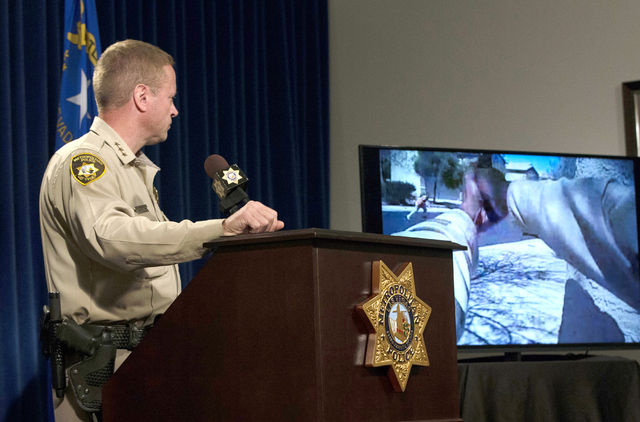 LVMPD Undersheriff Kevin McMahill speaks about last weeks OIS Monday, April 4, 2016, as he watches video from a body camera at a news conference at LVMPD Headquarters. Ben Hagan/Las Vegas Review-J ...