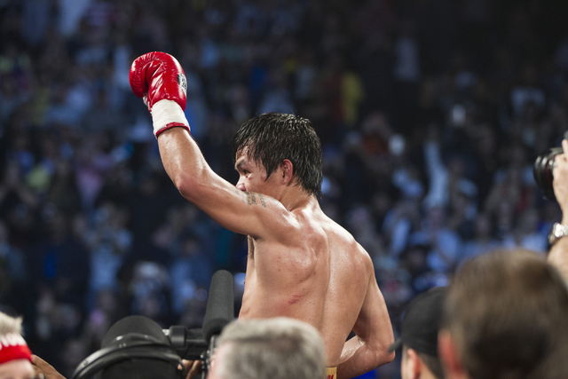 Manny Pacquiao celebrates his victory against Timothy Bradley in the WBO International welterweight championship boxing bout at the MGM Grand Garden Arena on Saturday, April 9, 2016, in Las Vegas. ...