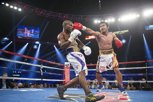 Timothy Bradley, left, moves away from a punch by Manny Pacquiao in the WBO International welterweight championship boxing bout at the MGM Grand Garden ArenaSaturday, April 9, 2016, in Las Vegas.  ...