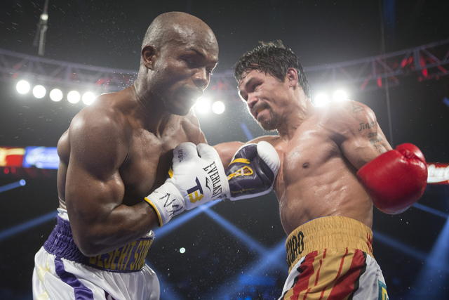 Manny Pacquiao, right, throws a punch against Timothy Bradley in the WBO International welterweight championship boxing bout at the MGM Grand Garden ArenaSaturday, April 9, 2016, in Las Vegas. Pac ...
