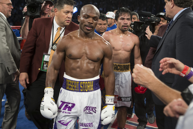 Timothy Bradley, left, and Manny Pacquiao walk in the ring at the end of their WBO International welterweight championship boxing bout at the MGM Grand Garden ArenaSaturday, April 9, 2016, in Las  ...
